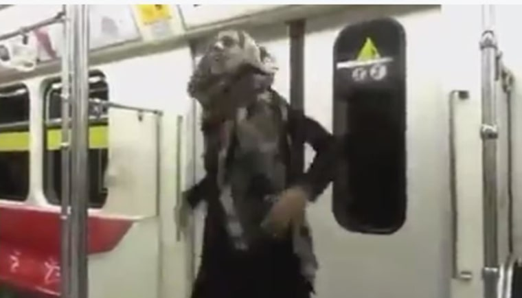 Image: Woman dancing in Tehran subway