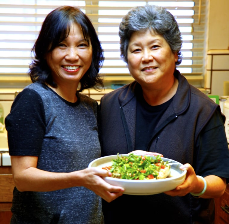 Priscilla Ouchida (left) and Joanne Morita (right) prepare Grandma Bette's Watercress Tofu Salad.