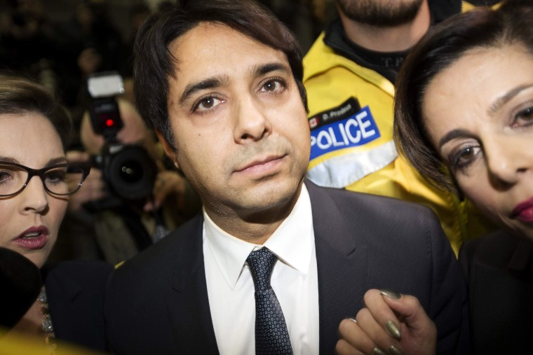 Image: Canadian celebrity radio host Jian Ghomeshi leaves court after getting bail on multiple counts of sexual assault in Toronto
