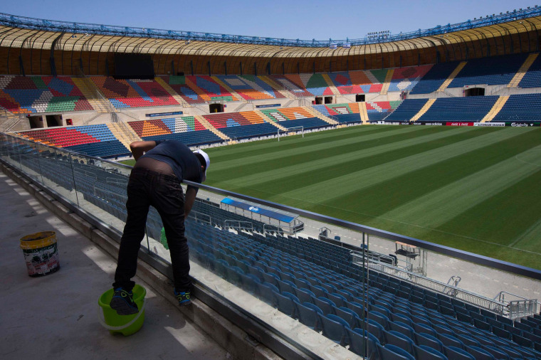 Image: A worker cleaning glass at Teddy Stadium in Jerusalem