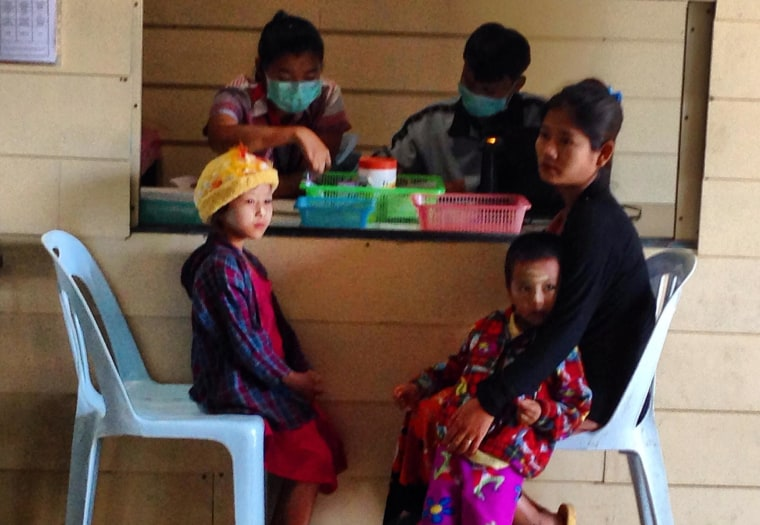 A Karen woman and her children wait for a blood test at the Wang Pha clinic.