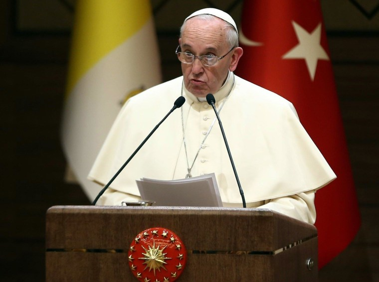 Pope Francis speaks during a joint press conference with the Turkish president at the presidential palace in Ankara on November 28, 2014. Pope Francis called for dialogue between faiths to end the Islamist extremism plaguing the Middle East as he visited Turkey for his first visit to the overwhelmingly Muslim but officially secular state.