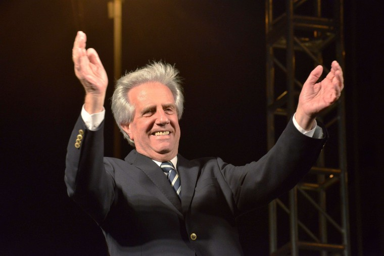 Image: Elected President Tabare Vazquez gestures during a celebration rally in Montevideo after knowing the results of a runoff election