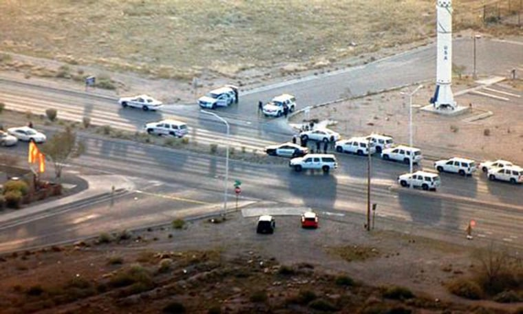 Image: Police vehicles gather near Kirtland Air Force Base in Albuquerque, N.M., on Monday, Dec. 1.