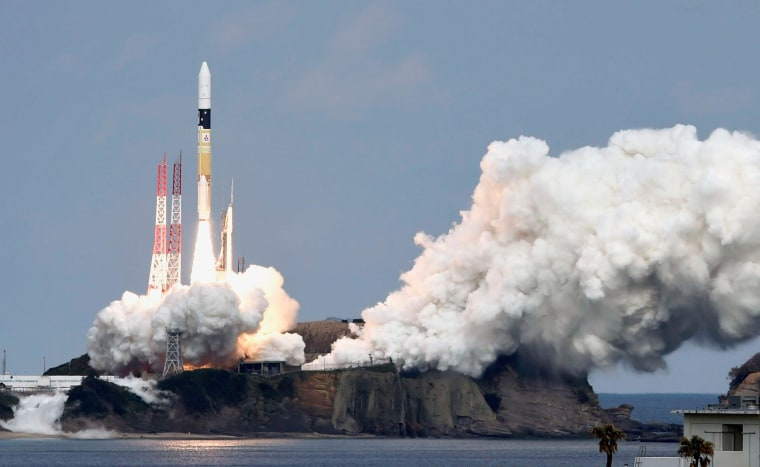 Image: A H-IIA rocket carrying Hayabusa 2 space probe blasts off from the launching pad at Tanegashima Space Center on the Japanese southwestern island of Tanegashima