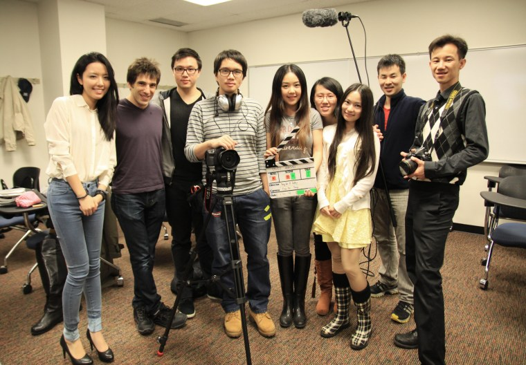 """Director Yung-Jen Yang (fourth from left) and Producer Cathy Jiang (fifth from left) wrapping up the first day of shooting """"Study Abroad."""""""