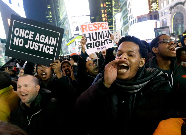 Image: Protesters shout at Times Square after it was announced that the New York City police officer involved in the death of Eric Garner is not being indicted,