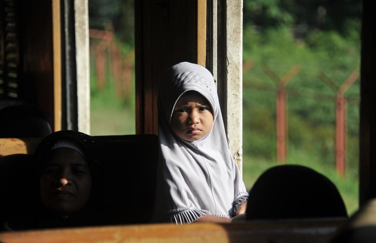 A girl travels in a train after service resumed on the southern line to the border town of Sungai Kolok two weeks after a blast on the railway tracks in the Rangea district of Thailand's restive southern province of Narathiwat on May 30, 2014.