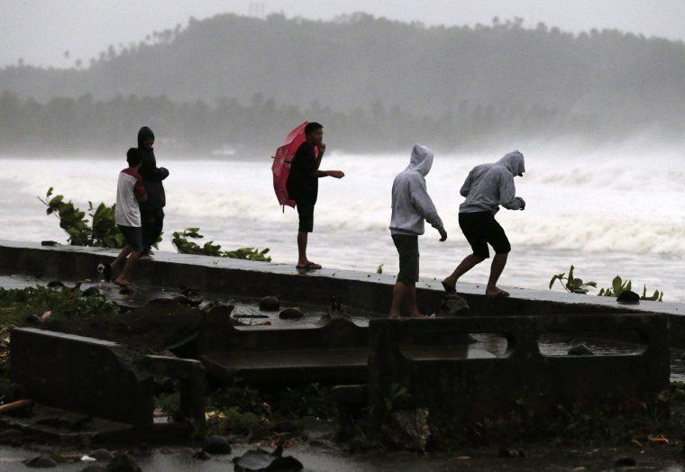 Image: Residents evacuate due to Typhoon Haqupit