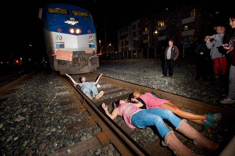 Image: Protesters block an Amtrak train in Berkeley