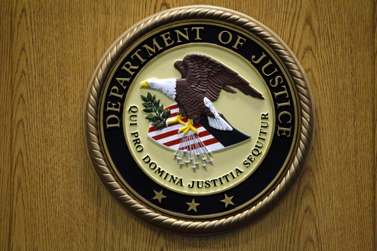 A Department of Justice logo is shown on a podium during a news conference on Sept. 30, 2010, in Philadelphia.