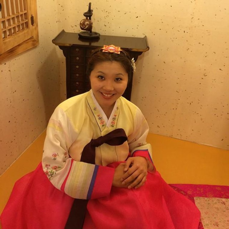 Sporting a traditional Korean dress (hanbok) at Hanbok Cafe in Seoul, South Korea.