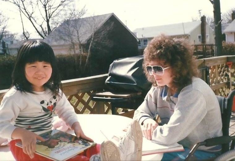 Reading my favorite childhood book, The Sweet Smell of Christmas with my mother in our backyard in Farmingdale, NY.