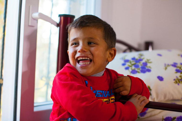 Murad, 2,  reacts after being shown his bedroom at the Beyti orphanage in Reyhanli, southern Turkey.
