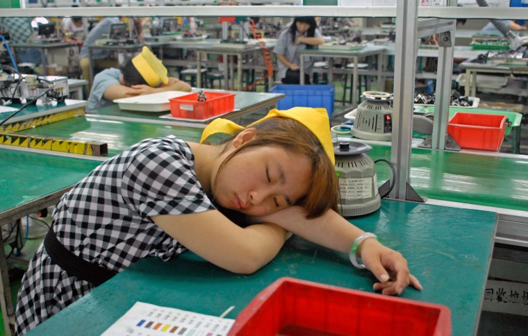 Workers nap during their shift at a computer hardware factory in the manufacturing city of Dongguan, China.