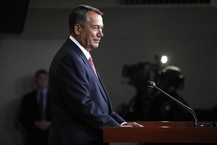 Image: Boehner smiles during a news conference at the U.S. Capitol in Washington