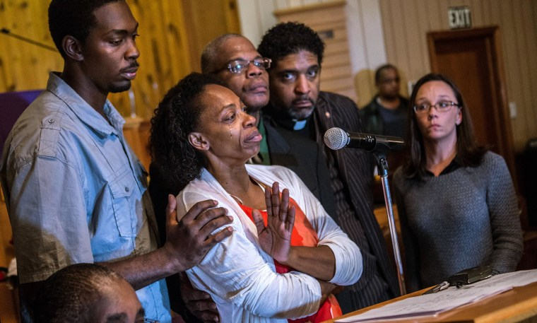 Image:  Claudia Lacy, center, cries as she thanks the people that showed up at First Baptist Church in Bladenboro, N.C., to listen to the Rev. Dr. William Barber II, president of the North Carolina State Conference of the NAACP, talk about the development
