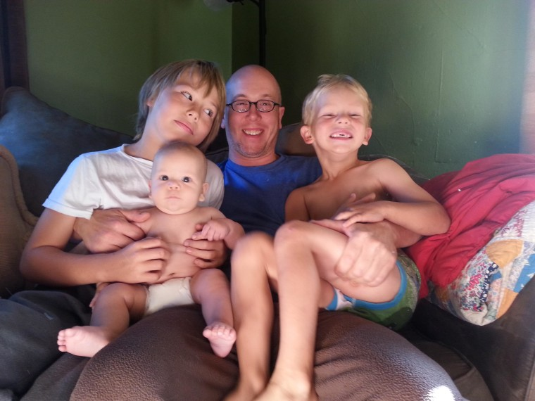 Zach Diamond with his three sons: Jackson, 9; Henry, 4; and Solomon, 6 months. Solomon was born healthy after his parents were told he had a fatal genetic disorder.