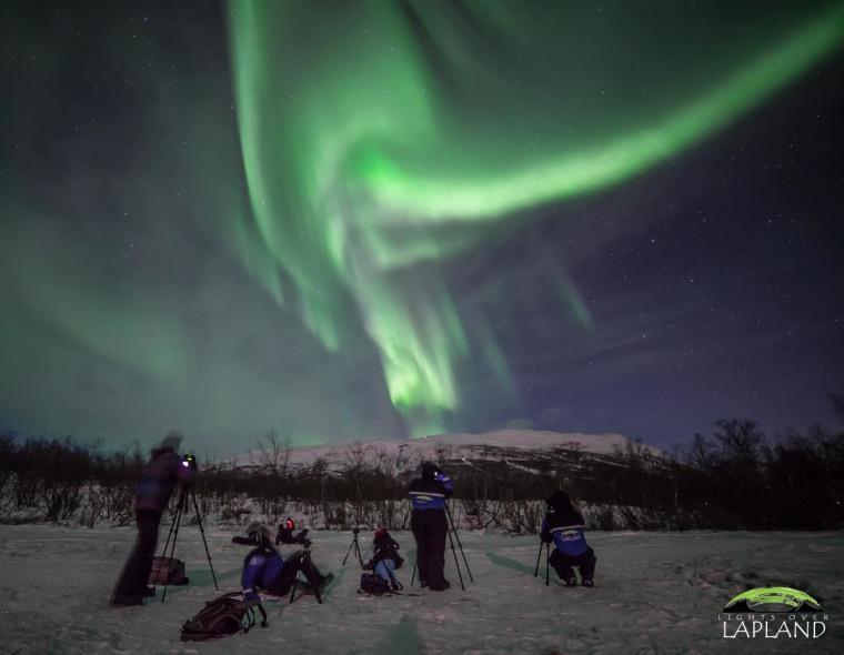Lights Over Laplands' guests set up cameras to snap pictures of the northern lights over Abisko National Park in Sweden.