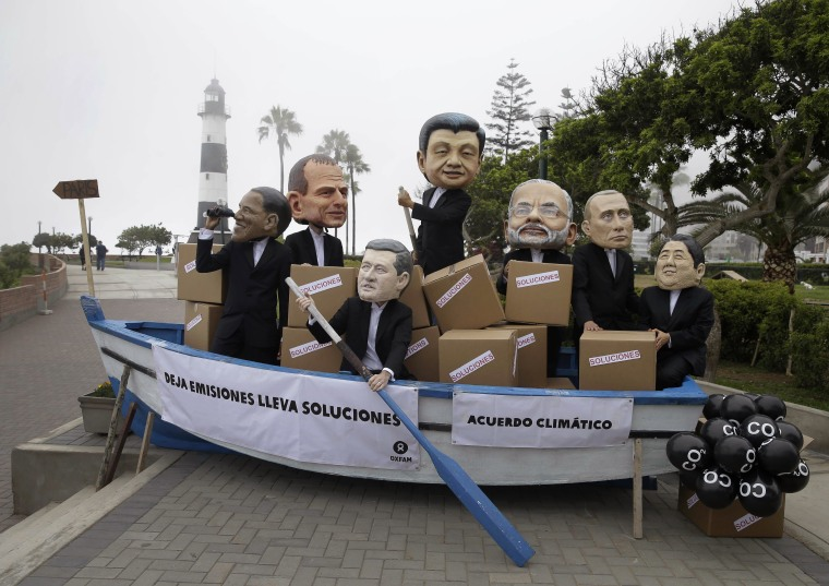 Image: Activists perform as heads of state during the Climate Change Conference COP20 in Lima Peru