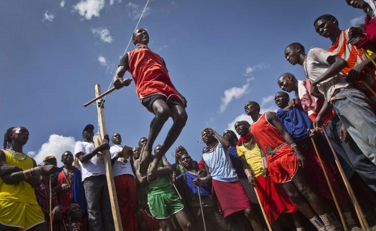 Image: A Maasai warrior makes the high jump at the annual Maasai Olympics