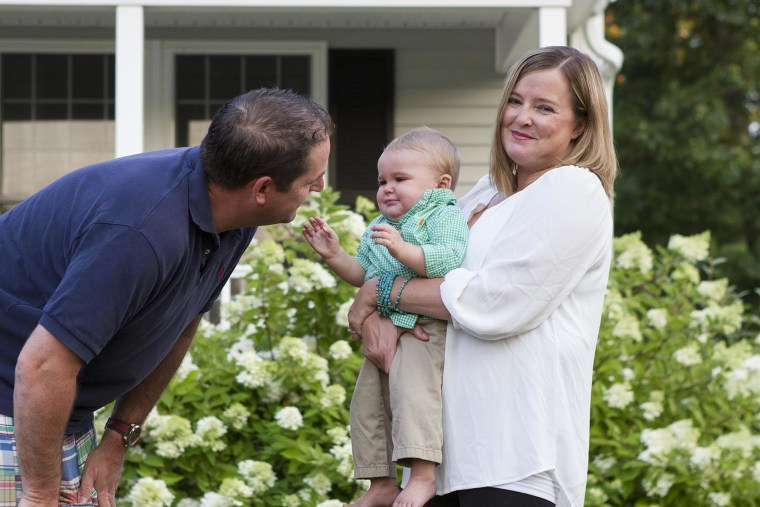 Stacie and Lincoln Chapman with their son Lincoln Sam. A screening test suggested Sam had Trisomy 18, but he was born healthy.