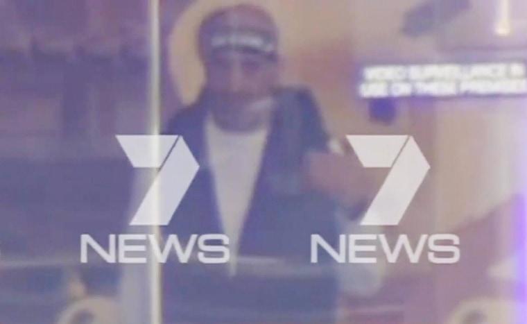Image: Suspected gunman inside cafe in Sydney