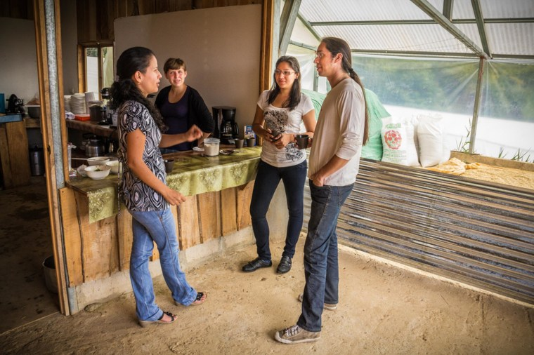 "Renowned Costa Rican musician Carlos ""Tapado"" Vargas, at right, talks to the Costa Rican woman coffee entrepreneurs who are the subject of the documentary ""A Small Section Of The World."""