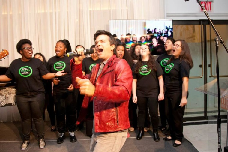 Sing for Hope Volunteer Artist Blake Whyte performs with the SFH Youth Chorus at the Lulu and Leo Gala.