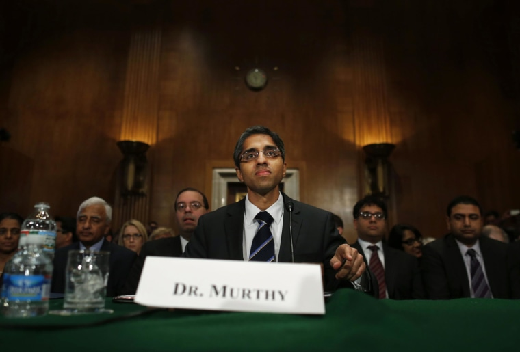 Dr. Vivek Hallegere Murthy, President Barack Obama's nominee to be the next U.S. Surgeon General, prepares to testify on Capitol Hill in Washington, Tuesday, Feb. 4, 2014, before the  Senate Health, Education, Labor, and Pensions (HELP) Committee hearing on his nomination.  (AP Photo/Charles Dharapak)
