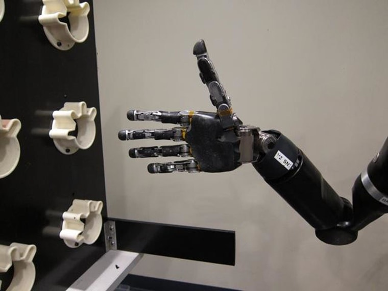 A robot hand at the University of Pittsburgh Medical Center offers hope to those with spinal injuries.