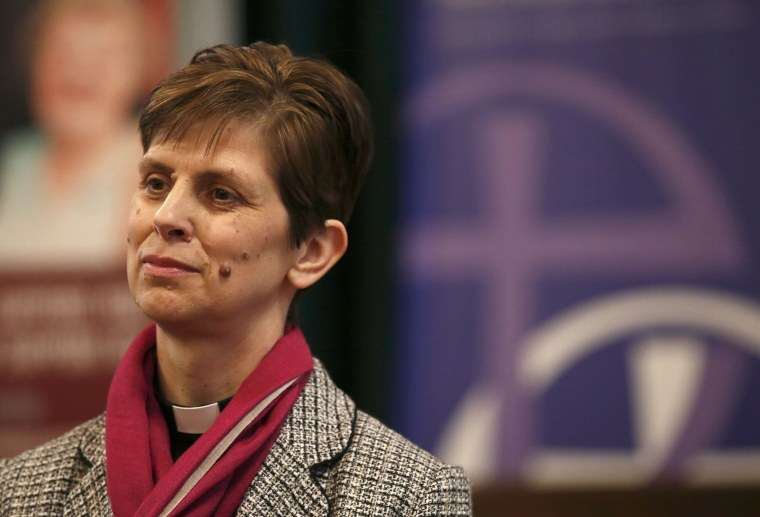 Image: Libby Lane, a suffragan (Assistant) bishop in the Diocese of Chester, listens as her forthcoming appointment as the new Bishop of Stockport is announced in the Town Hall in Stockport