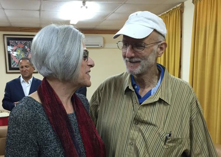 Image: American aid worker Alan Gross speaks with his wife Judy shortly before leaving Havana