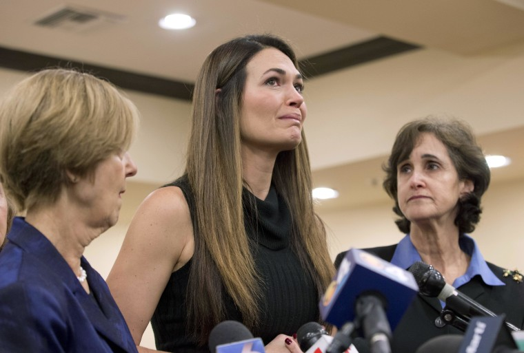 Marlene Alejandre-Triana, center, fights back tears as speaks during a news conference on Wednesday, Dec. 17 in Coral Gables, Fla., after President Barack Obama announced that he had secretly arranged prisoner exchanges with Cuban leader Raul Castro as part of an effort to normalize relations. Alejandre-Triana's father Armando Alejandre, the brother of Alejandre Ciresco and Alejandre-Khuly, was one of four victims of the 1996 Brothers to the Rescue shot down by the Cuban military.
