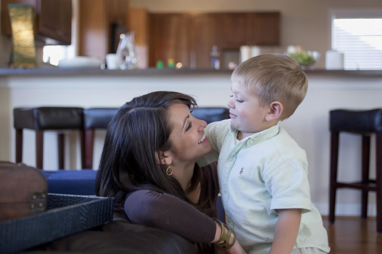 Two year old, Maddox Coursen Van Dorn, with his mother Nicole in the family's living room in Virginia Beach, Virginia, Nov. 2014. Maddox's father, Lt. J Wesley Van Dorn, was killed in a MH-53E Sea Dragon helicopter crash in January 2014.