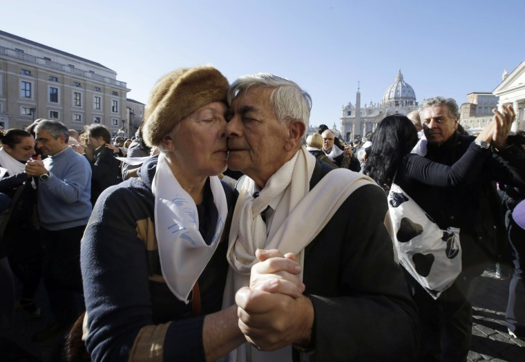 Image: A couple dances tango in front of St. Peter's Square