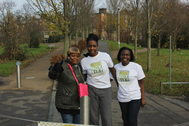 Memuna Janneh, center, stands with LunchBoxGift volunteers in London.
