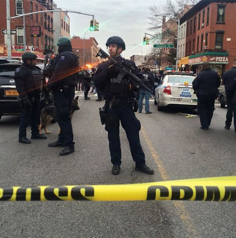 Two NYPD police officers were shot while sitting in a patrol car in Brooklyn, N.Y., on Dec. 20.