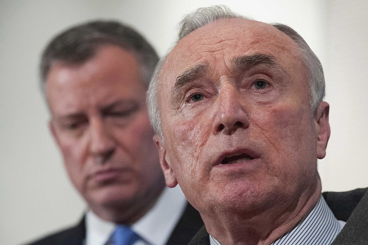 Image: New York Police Commissioner Bratton speaks as New York Mayor De Blasio looks on at a news conference at Woodhull Medical Center in Brooklyn, New York