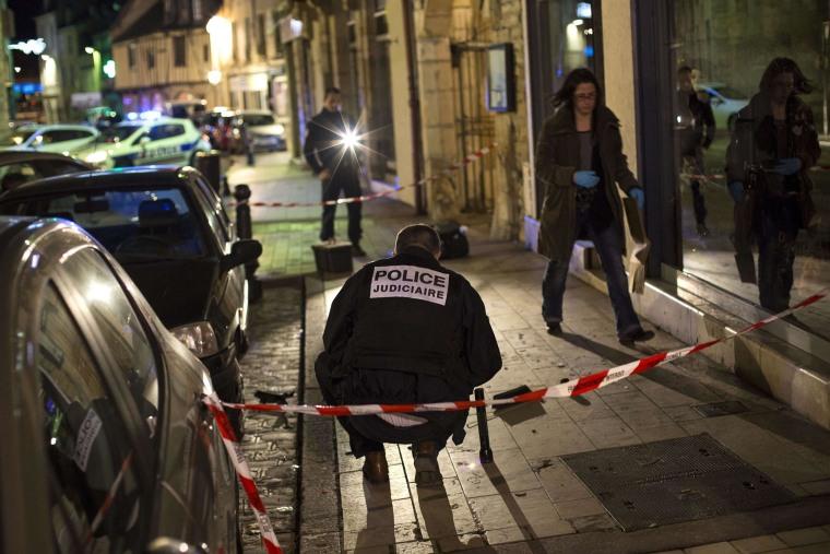 Image: Police examine the scener in Dijon