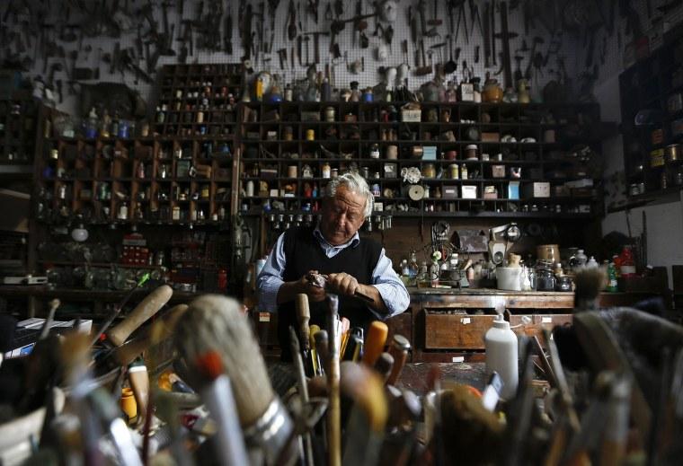 Image: Italian collector Domenico Agostinelli works in his museum in Dragona