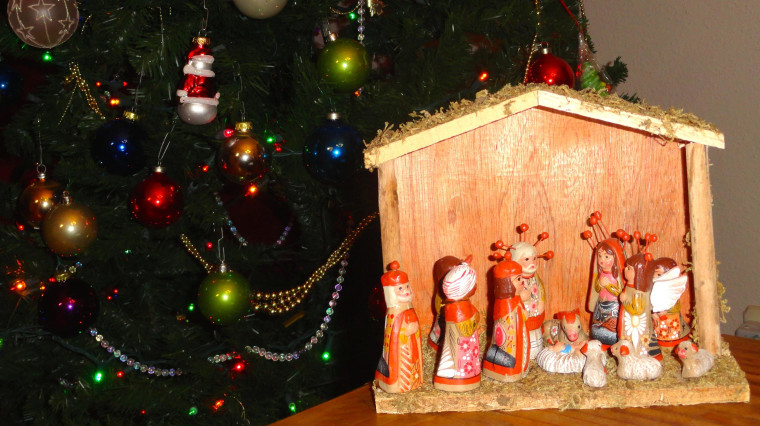 In contributor Claudia Deschamps's home, the traditional U.S. Christmas tree is also accompanied by a nacimiento, or creche of baby Jesus.