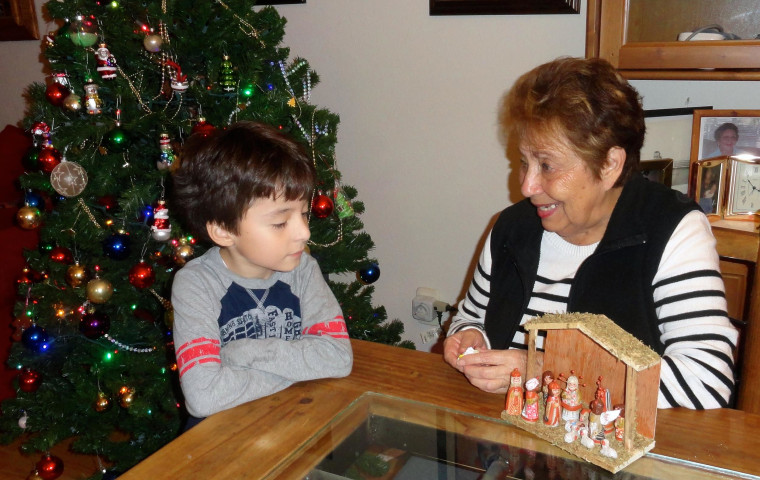 Claudia Deschamps's mother is explaining to her grandson about the Nativity scene.