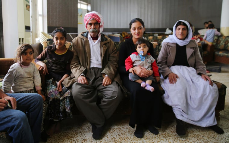 Image: Freya Azam Ali, second from right, sits with her family at the Khanake refugee camp in Duhok, Iraq