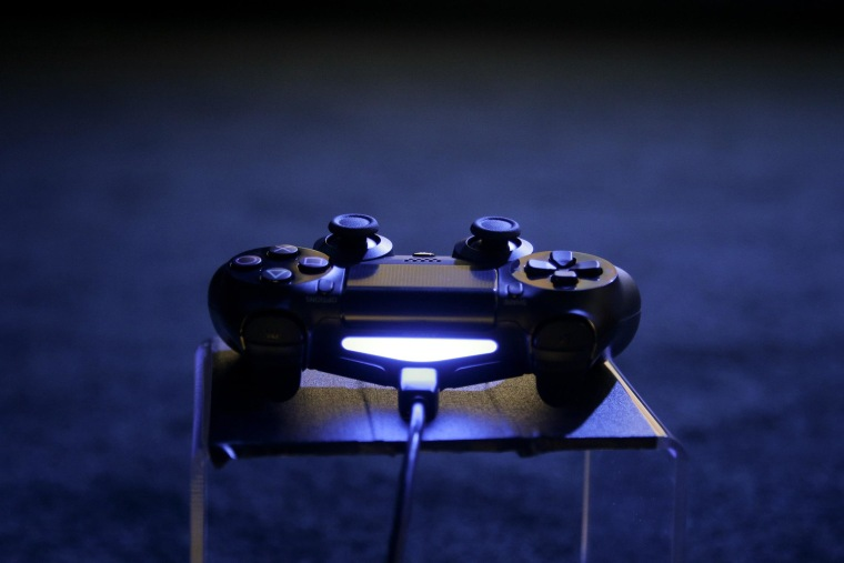 A controller for the new PlayStation 4 on display at the Sony PlayStation E3 media briefing in Los Angeles, on June 10, 2013.