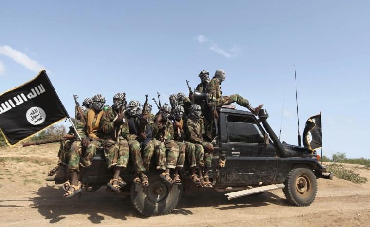 Members of al Shabaab ride in a pick-up truck outside Somalia's capital Mogadishu