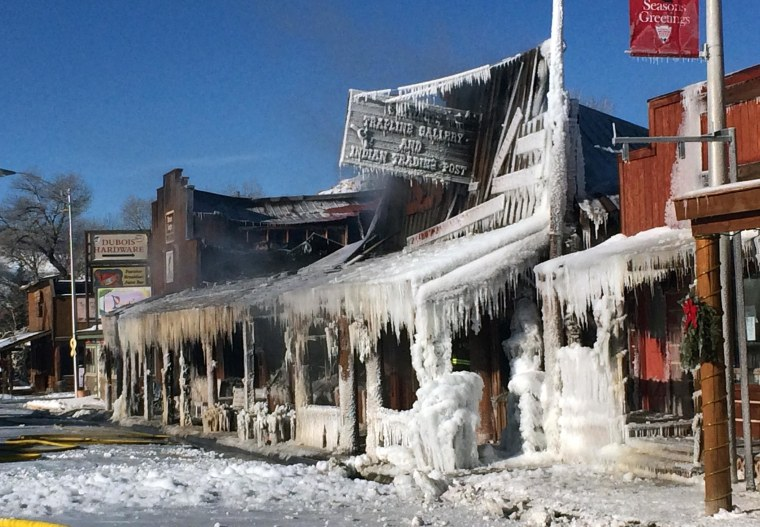 Image:  Huge flames ripped through the historic buildings in the picturesque western Wyoming town as firefighters contended with sub-zero temperatures that froze their hoses and other equipment. Four buildings containing more than a dozen businesses were