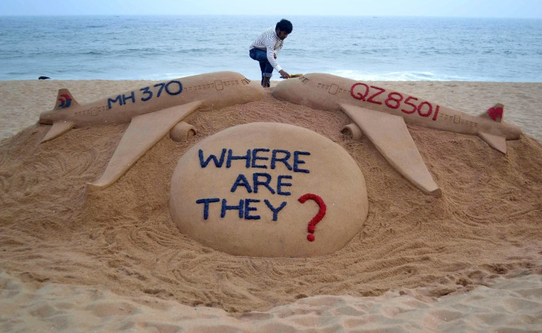 Image: Indian sand artist Sudarsan Pattnaik gives the final touches to a sculpture on Dec. 29