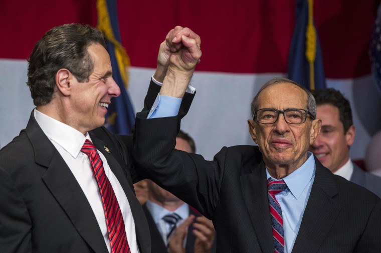 Democratic Governor Andrew Cuomo reacts with his father Mario after being re-elected for the U.S. midterm race in New York, November 4, 2014.