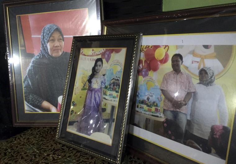 Image: Framed photos of four family members abords AirAsia Flight QZ8501